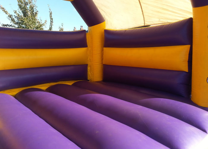 Purple & Yellow Bouncy Castle Hire Huddersfield