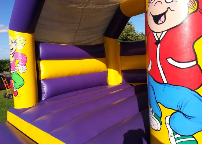 Purple & Yellow Huddersfield Bouncy Castle Hire