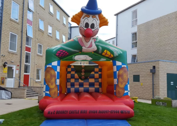 Adult clown themed bouncy castle